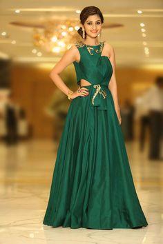 emerald green cockail gown , cutout green gown , side hair bun