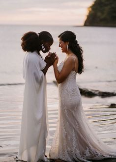 This moment between the two newlyweds on the beach is so tender and we love it so much! | Image by Raw Shoots Photography
