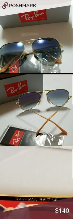Ray ban aviator sunglasses New ray ban 3025 aviator blue gradient lense . Made in italy SIZE 55mm. Comes with case and cloth. Purchase this glasses but did not fit good with my face structure Ray-Ban Accessories Sunglasses
