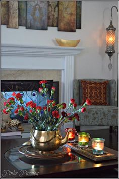 Interior, Indian inspired decor, Indian home decor, global decor, brass vase, Yankee candle votives.