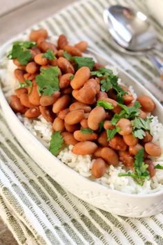 Dave Ramsey Slow Cooker Beans and Rice Recipe--if you're trying to cut down on your grocery bill I have a nourishing and inexpensive slow cooker beans recipe. We start with dried pinto beans (cheap!) and cook them all day while you're at work (earning money to pay off your debts). Add in some salt, cumin, garlic powder and tomato sauce and you have dinner (or lunch)!