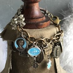 Mary in Blue vintage assemblage charm bracelet. A personal favorite from my Etsy shop https://www.etsy.com/listing/536939097/mary-in-blue-vintage-religious-medal