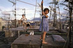 Children playing on the rooftop in Kowloon Walled City, Hong Kong, China, photography by Greg Girard. - Children playing on the rooftop in Kowloon Walled. Kowloon Walled City, Kai Tak Airport, Hong Kong, Book City, City Block, Slums, Historical Pictures, Looks Cool, Kids Playing