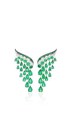 These scintillating earrings, intricately embellished with round brilliant diamonds, feature lavish Gemfield sourced Zambian emeralds cascading throughout.