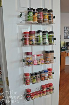 Easy $1 DIY Spice Racks made from dollar store cooling racks (she bent them i half, and attached them to the door!!!)