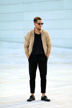 Busy days call for a simple yet stylish outfit, such as a camel bomber jacket and black chinos. Black leather derby shoes will add elegance to an otherwise simple look. Shop this look on Lookastic: https://lookastic.com/men/looks/tan-bomber-jacket-black-crew-neck-t-shirt-black-chinos/16110 — Tan Bomber Jacket — Black Crew-neck T-shirt — Black Chinos — Black Leather Derby Shoes