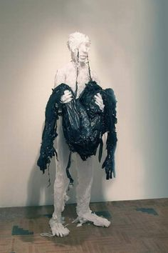 Using trash bags, unused grocery bags and plastic sheets, Pakistani artist Khalil Chishtee creates life-sized figures racked with emotion.