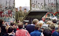 November 11 1989: West Berliners crowd in front of the Berlin Wall as they watch East German border guards demolish a section of the barrier near Potsdamer Square.