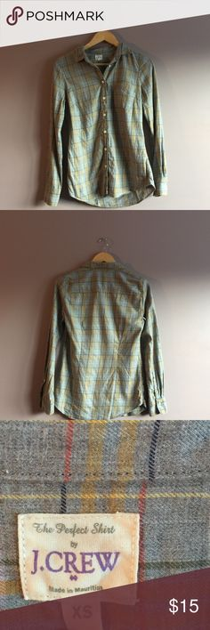 """J. Crew Women's Multi-Color Plaid Button Up J. Crew Women's Multi-Color Plaid Button Up  •Size: X-Small •Material: 100% cotton •Shoulder to shoulder: 14.5"""" •Armpit to armpit: 17"""" •Length: 27"""" •Sleeve length: 24.5""""  •Made in Mauritius •Machine wash cold •From a smoke-free home •In excellent condition   Fast shipping (same day) during business days   No trades  Make me an offer!!!  Bundle & save!! J. Crew Tops Button Down Shirts"""