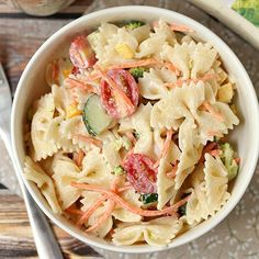 This veggie filled pasta salad is made in a jar and stored in the fridge so you can grab and go!