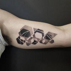 Geometrical tattoo art by Ben Doukakis