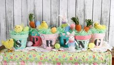 Painted clay pots with Easter grass