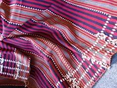Philippines: Gaddang textile    The Gaddang are a tribal group to the north-east of Manila, in the provinces of Isabella and Cagayan. This is a modern reproduction of the traditional striped Gaddang textiles embroidered with small white beads.