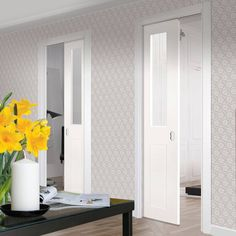 Deanta Unilateral Pocket Eton White Primed Victorian Shaker Door with Clear Safety Glass.    #unilateraldoors  #pocketdoors  #hiddendoors  #doors