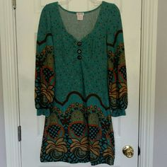 Funky People Long Sleeved Dress Worn a couple times but in great condition. Super funky dress. Unique piece. Juniors size large. Has a little stretch but I would say is best for Juniors sizes between 7-11. Funky People Dresses Long Sleeve