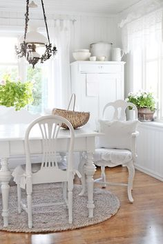 White kitchen table that's not stark. Feels cozy and inviting.