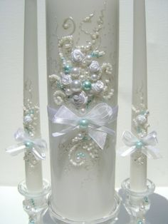 Wedding unity candle set - 3 candles and 2 small candleholders, hand decorated with ribbon roses bows and pearls in white and tiffany blue. Wedding Flutes, Wedding Unity Candles, Wedding Glasses, Dollar Tree Centerpieces, Candle Centerpieces, Vases, Wedding Guest Table, Candle Art, Wedding Crafts