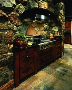 Rock influence in the kitchen makes a hearth that has old world charm.  http://www.realestateinvesting-gurureview.com