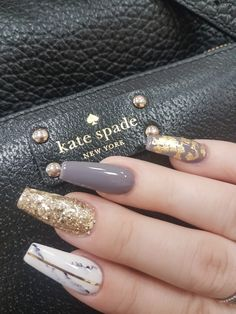 Gold glitter, gold leaf, charcoal and marble nail design