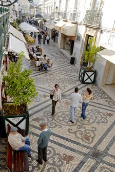 Pedestrians stroll along charming walkways tiled in intricate patterns in Faro, Portugal. Faro's other attractions include beaches and a historic walled town. (AP Photo/Associacao Turismo do Algarve/Portuguese National Tourist Office, Luís da Cruz)