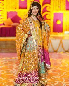 Here are the mehndi/dholki dresses I found and saved in February Bridal Mehndi Dresses, Mehendi Outfits, Pakistani Wedding Dresses, Bridal Outfits, Stylish Dresses For Girls, Stylish Girl Pic, Girls Dresses, Pakistani Bridal Hairstyles, Bridal Pictures