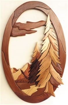 Oval-God's Country Plan This terrific intarsia piece shows just how amazing God's country really is! With majestic pines in the foreground and the mountains in the back a peaceful feeling just comes o