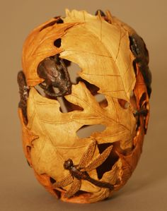 Forest Creatures by Michael Kehs. Cherry wood, 5 inches in diameter and 7 inches tall. Leaf types are sugar maple, white oak, red oak, elm and chestnut oak. Five creatures too, dragonfly and beetle shown here.