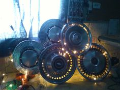 Hub cap lighted sculpture made for my daughter's boyfriend..with her help