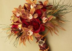 Cymbidium Orchids Red Roses and feathers