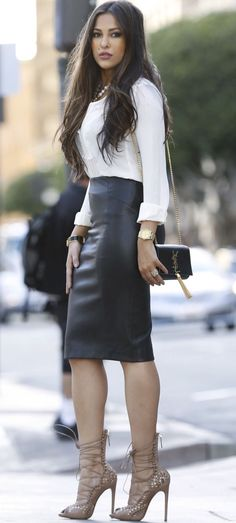 Black leather high waisted midi skirt with strappy heels