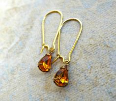 Vintage Gold Topaz Teardrop Faceted Glass Stones from Western Germany by TimelessTreasuresbyM on Etsy