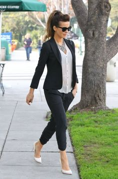 Kate Beckinsale stylish street style in dark slacks, white top and high heels. Pure class.