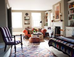 """Frank's 30-foot-long master bedroom was originally two rooms. """"It's long and narrow, so I kept adding color and pattern until it felt comfortable,"""" he says. """"The mix is more exuberant than the rest of the house."""" Orange chesterfield sofa is vintage. Walls are Benjamin Moore's Victorian Garden. William Abranowicz  - HouseBeautiful.com"""
