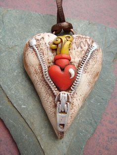 Unzipped sacred heart by MarieSegal, via Flickr
