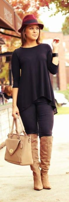 all black outfit, with brown boots, brown hat and brown bag