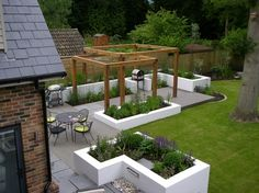 Garden landscaping idea with bbq and seating area.Garden Design Ideas by DfM Landscape Designers