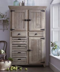 Our wooden Market Larder cupboard in muted limed wood finish is specially designed with crate-style drawers to allow air to circulate in your fruit