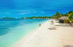 NEGRIL, JAMAICA - Sandals Negril - Where no resort can be as tall as the tallest palm tree, this resort is situated on a beautiful stretch of white sand beach with rooms as close to the water as you can get. Sunsets and a long walkable beach make this resort a must do for every vacationer!