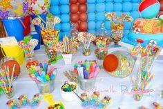 Fiesta en la piscina. pool party, decoraciòn sweet, golosinas. colors, table dessert http://antonelladipietro.com.ar/blog/2012/11/cumple-veranieg/