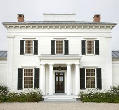 A new Greek Revival home by GP Schafer. Doric columns, twin chimneys, and black shutters. Black Shutters, Exterior Shutters, Louvered Shutters, White Siding, Country Shutters, Exterior Paint, White Houses, Home Fashion, Curb Appeal