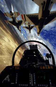 "View from the cockpit of an F-16, while flying in formation. This is the widely known aerobatics team known as the ""Thunderbirds""."