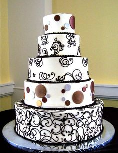 Check out layer 2 - has words in the swirls!  5  tier round custom white, brown, black and silver modern fondant elegant curlicues and polka dots unique wedding cake design