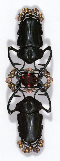 Blister Beetle Corsage Ornament by René Lalique, ca.1903-04. Gold, silver, tourmaline, enamel, glass; 14.9 cm long