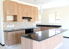 Earp Construction develops and sells properties in George on the Garden Route in South Africa. There are a range of design styles and sizes to suit your budget. Urban Village, Space Kitchen, Aluminium Windows, Brick Design, Plan Design, Home Kitchens, Property For Sale, South Africa, House Design