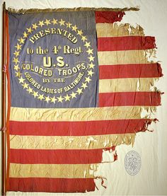 Fourth Regiment United States Colored Troops Civil War Flag. Silk mounted on a wooden pole (with the eagle missing).