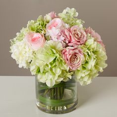 Features: -Made with faux silk. -Vase made of glass. -Pink color. Product Type: -Floral Arrangements. Color: -Pink and Green. Size: -Medium. Flower: -Mixed. Container Finish: -Clear. Seasonal