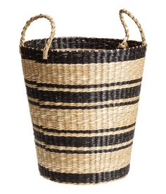 Storage basket in braided straw with two handles at top | H&M Home