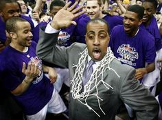 Coach Romar celebrates with the team.