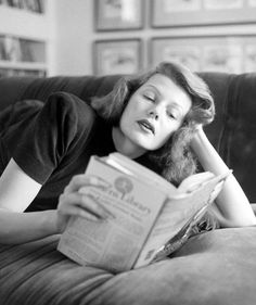 """Rita Hayworth reading Lincoln in her library (October 1948). Photograph by John Florea.  The book is a Modern Library edition of """"The Life and Writings of Abraham Lincoln."""""""