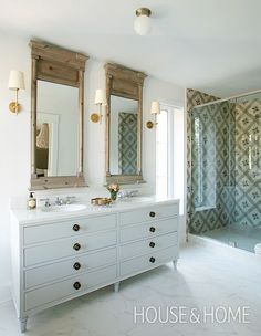 This Montreal bathroom has a definiteEuropean flair, thanks to patterned tile in the shower enclosure, a Louis XV-inspired vanity and matching trumeau mirrors.   Photographer: Maxime Desbiens   Designer: Mélanie Cherrier